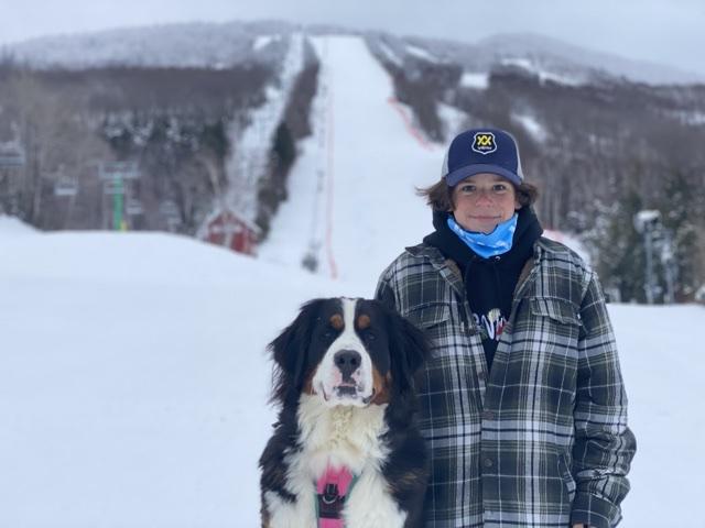 Ski boy and his Burke dog