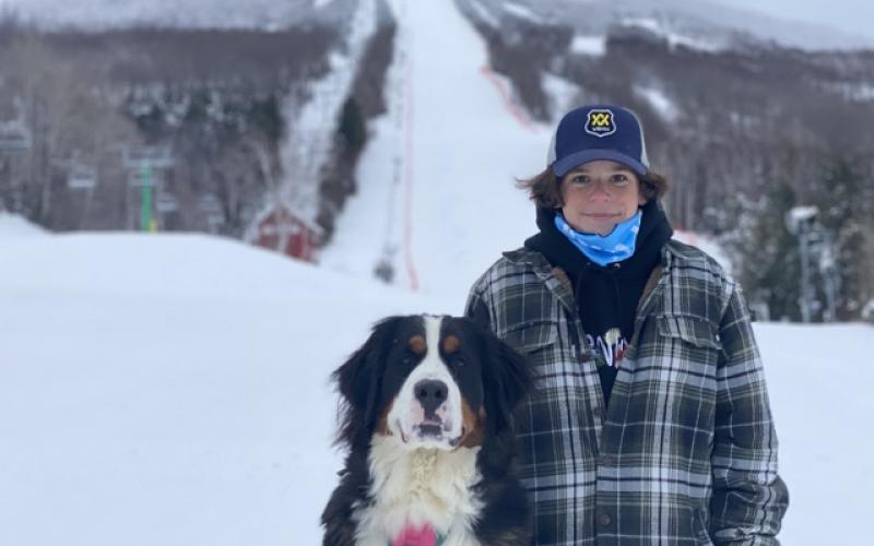 Ski boy and his Burke dog